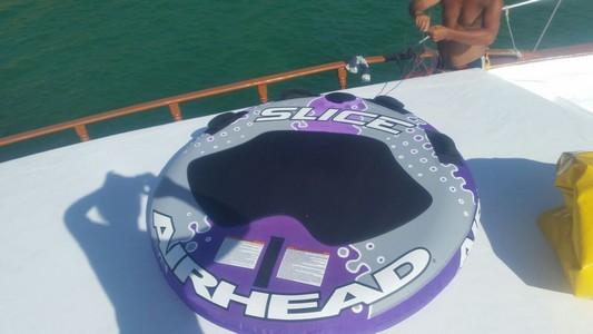 water transportation,purple,personal protective equipment,sport venue,boat