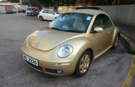 land vehicle,car,vehicle,volkswagen new beetle,motor vehicle